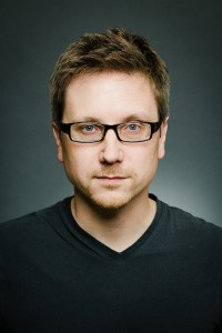 tom-headshot-glasses-med-color